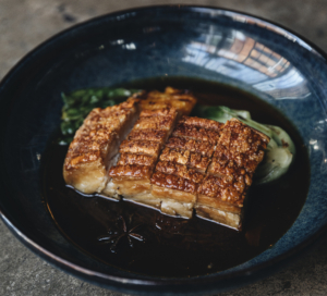 Roast pork belly with mandarin, black vinegar and miso sauce