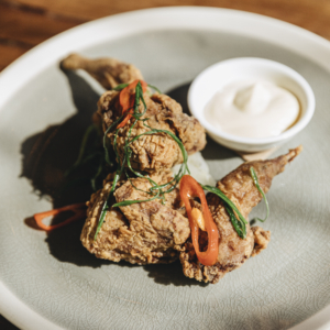 Salt and pepper quail with pickled fennel, sesame mayo